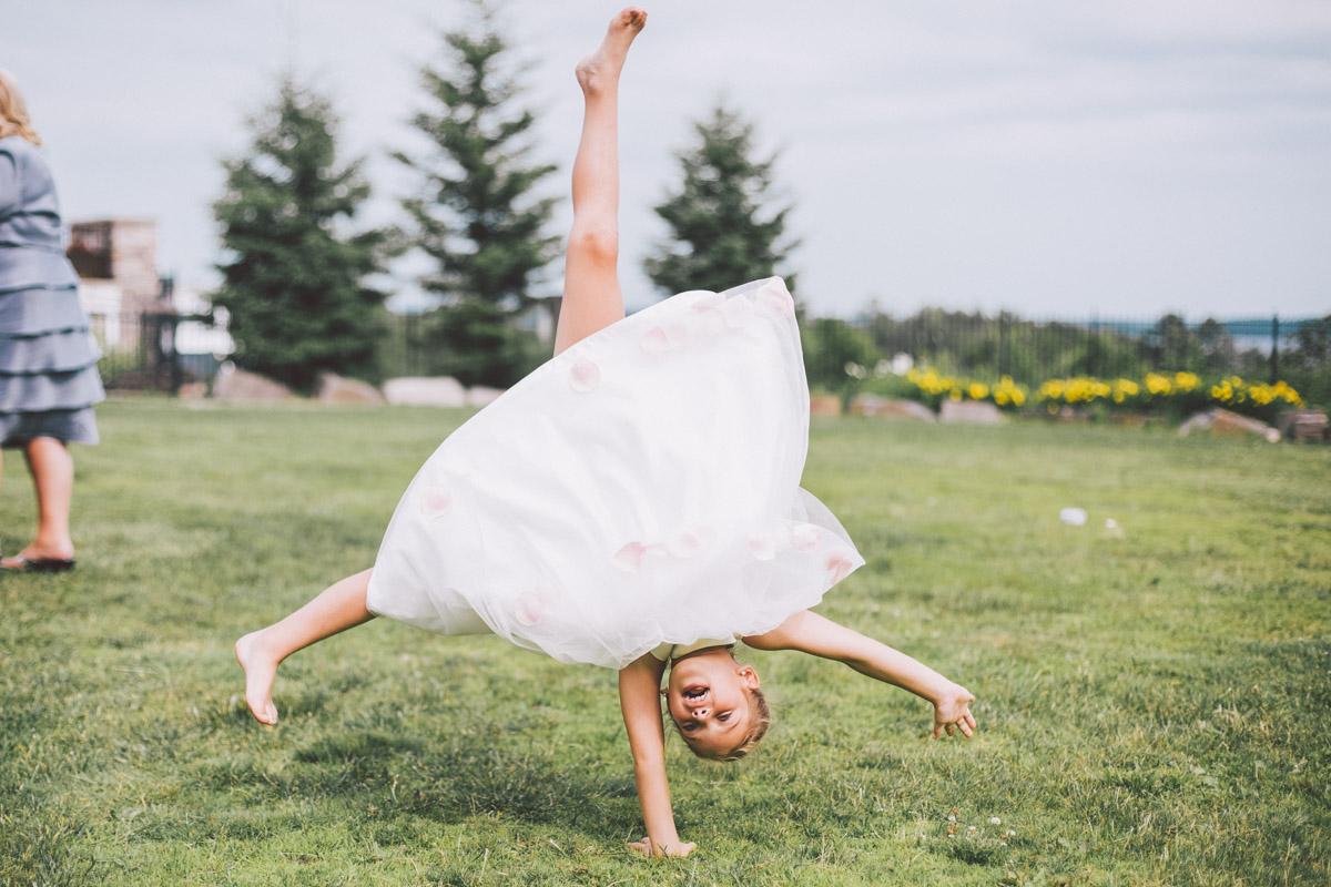 flower girl doing cartwheel