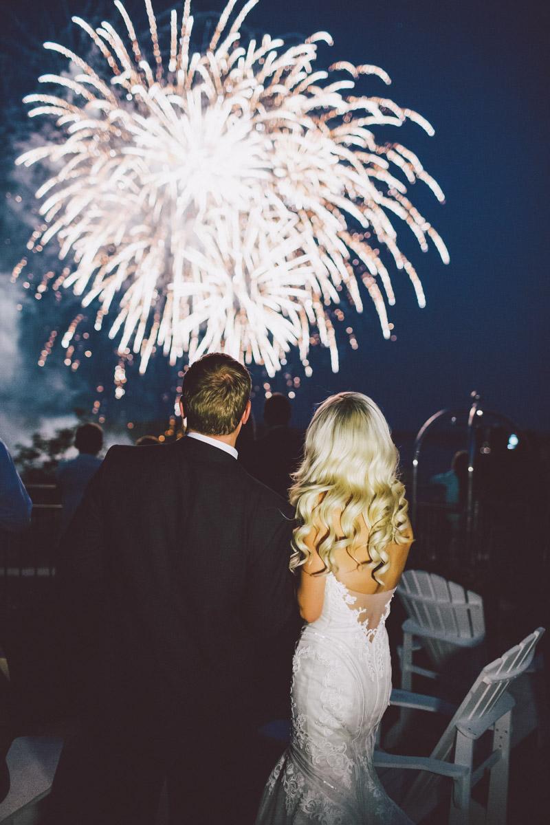 bride and groom under fireworks