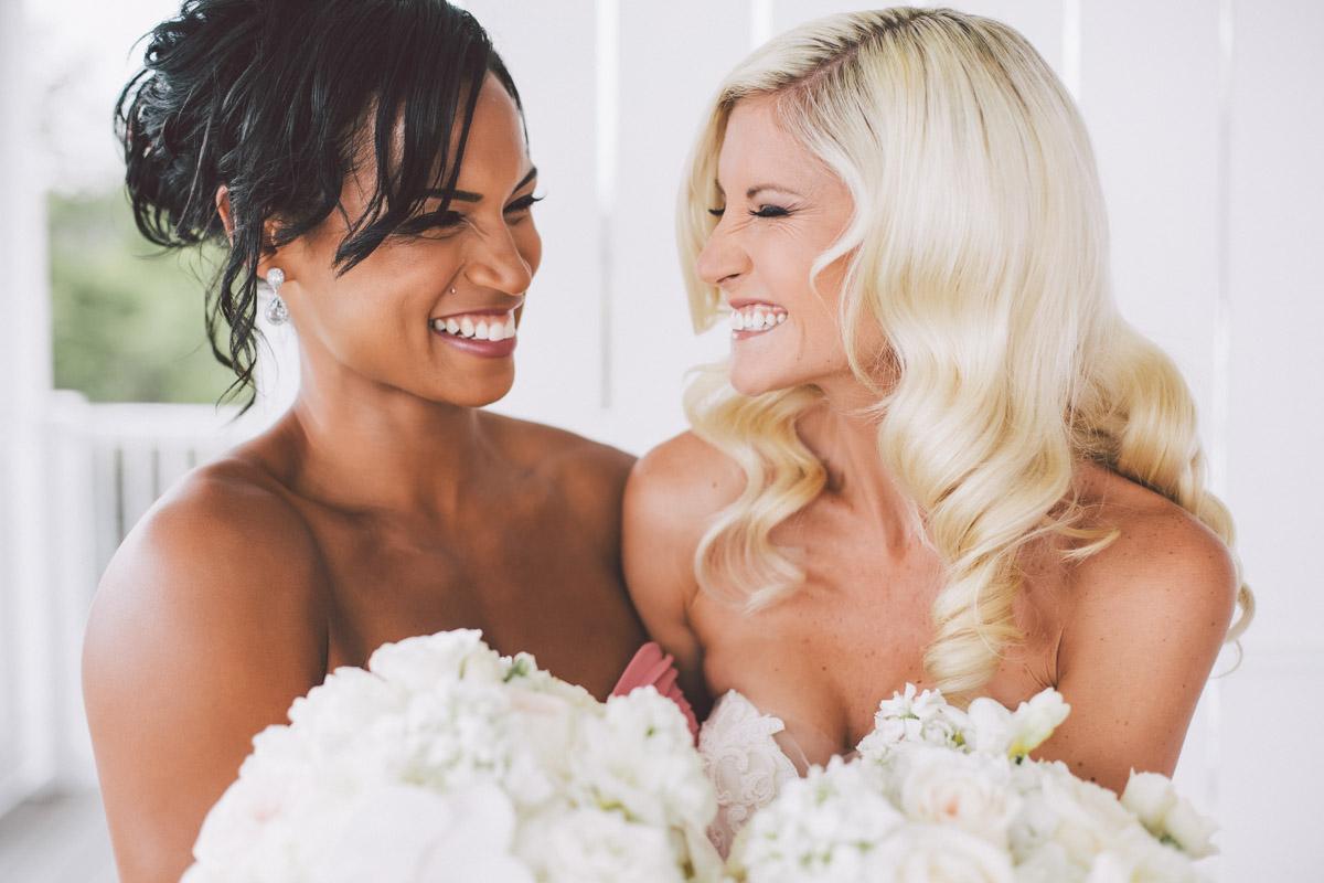 girlfriends laughing at th ewedding