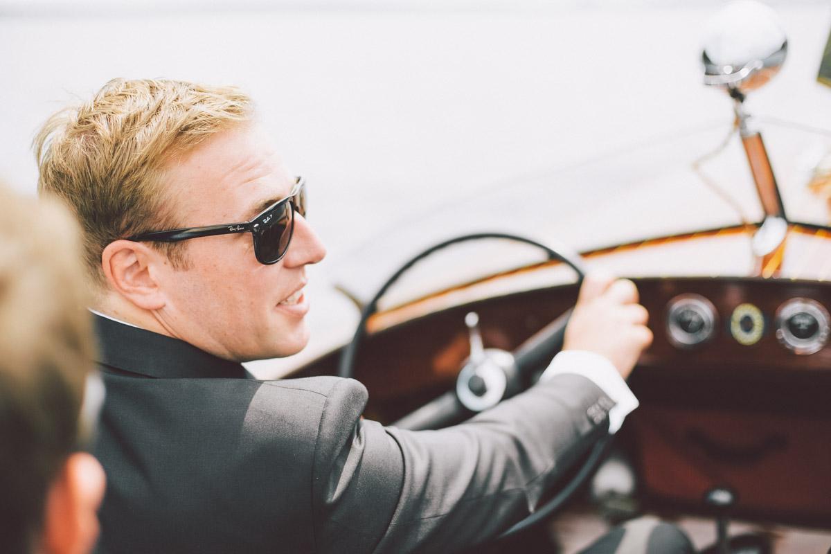 groom steering the boat