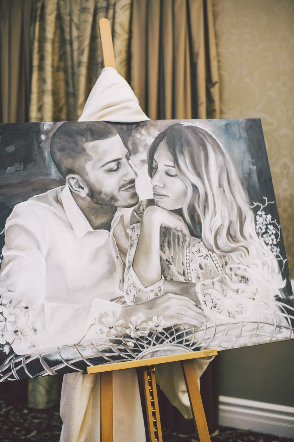 Painted canvas of bride and groom