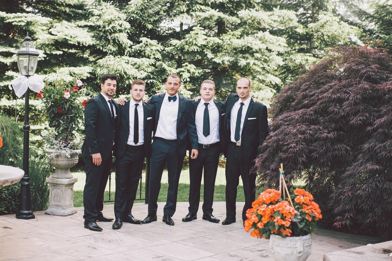 groomsmen in the parents backyard