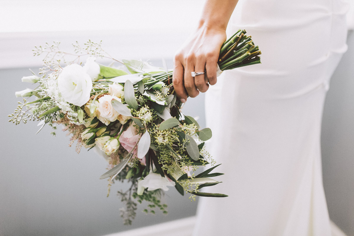 holding bridal bouquet