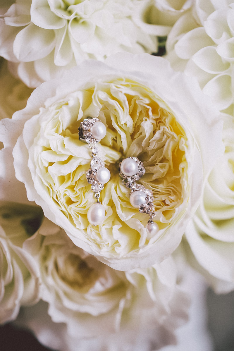 brides accessories on and flowers
