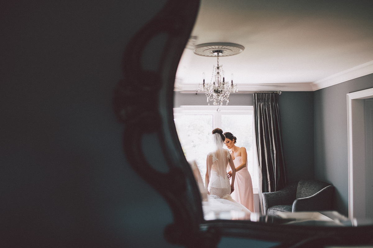 creative shot of the bride in the mirror