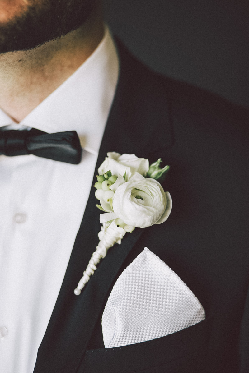 flower on black tuxedo lapel