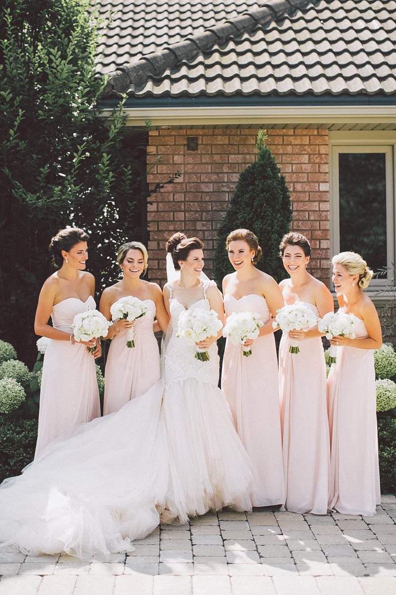 bridesmaids posing for photos