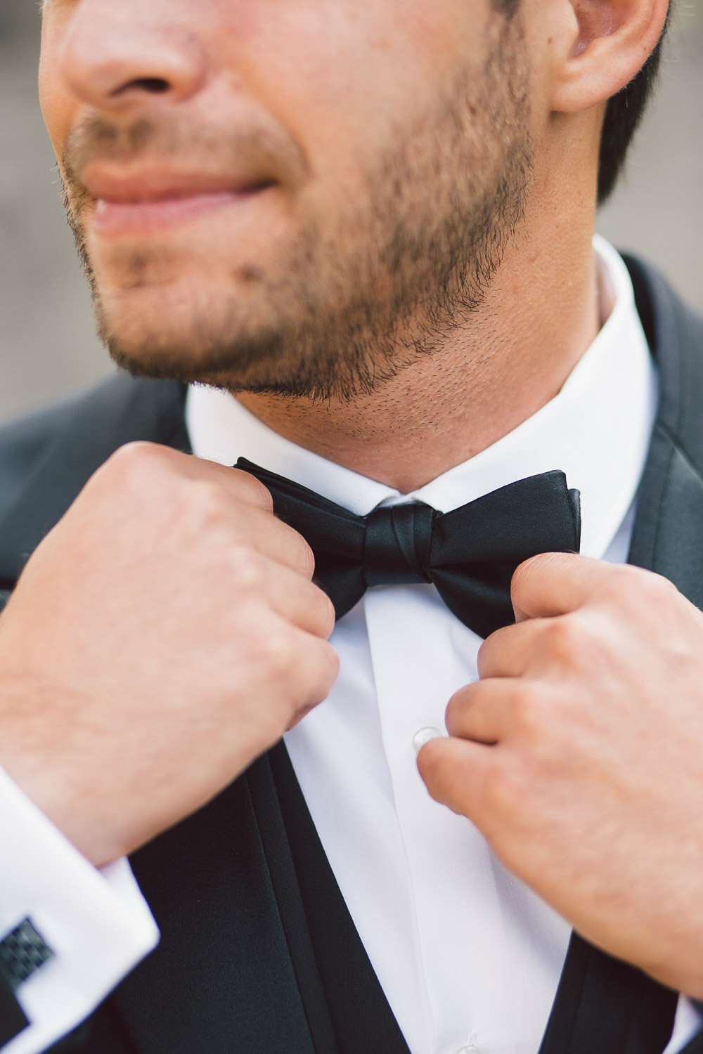 fixing grooms bow tie