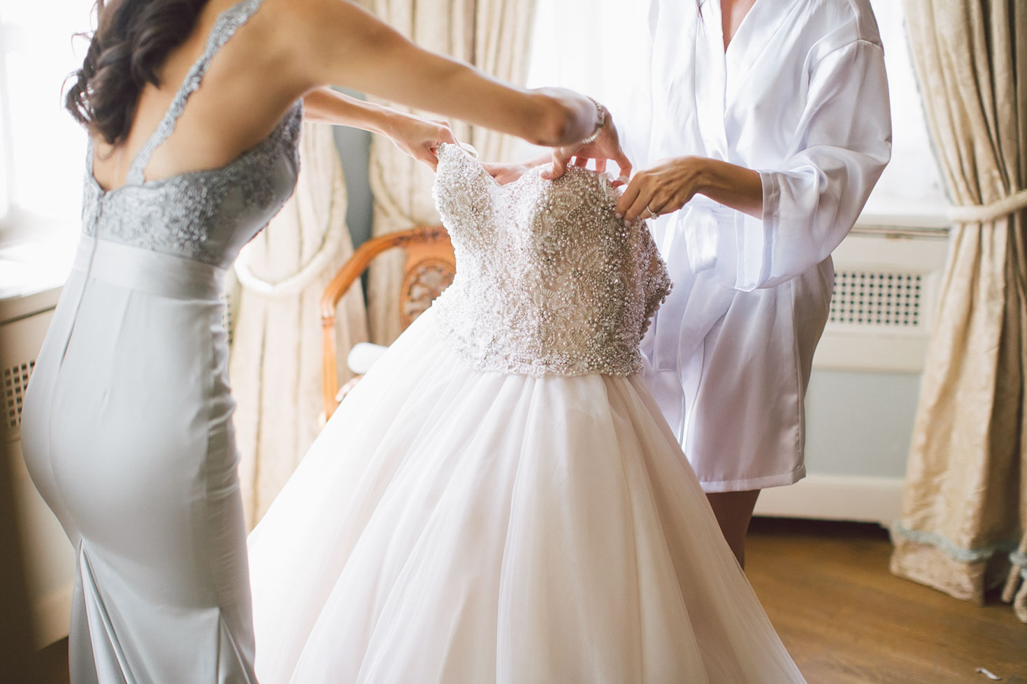 putting wedding dress on