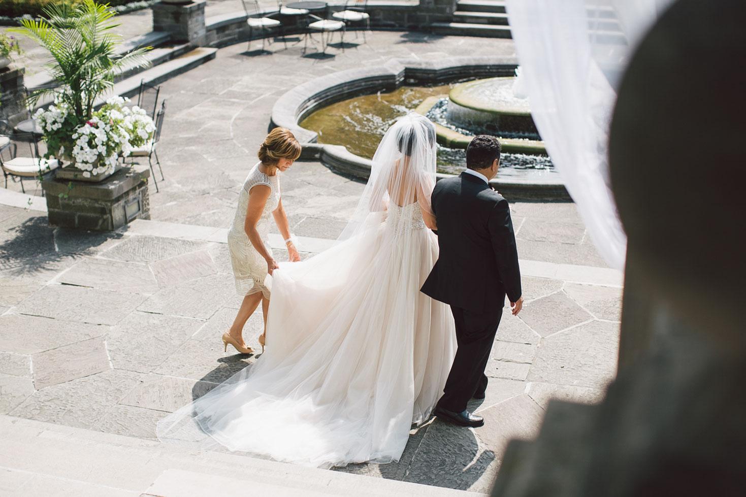 bride escorted down the aisle