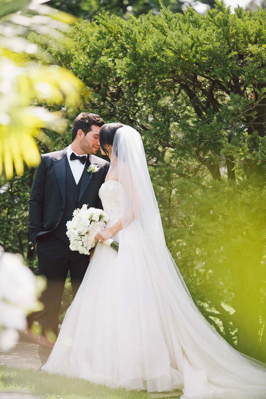 bride and groom posing at graydon hall