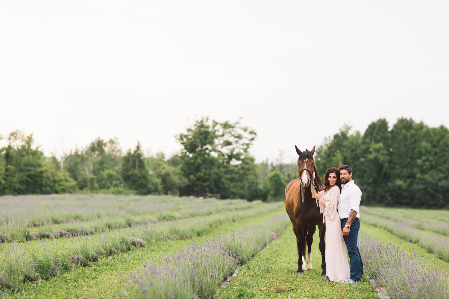 couple posing in the field