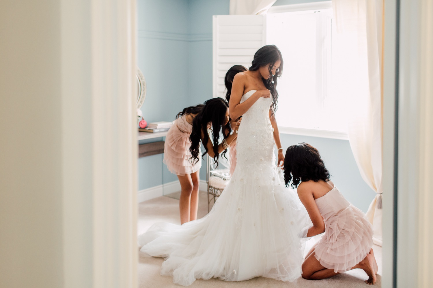 bride putting on the dress