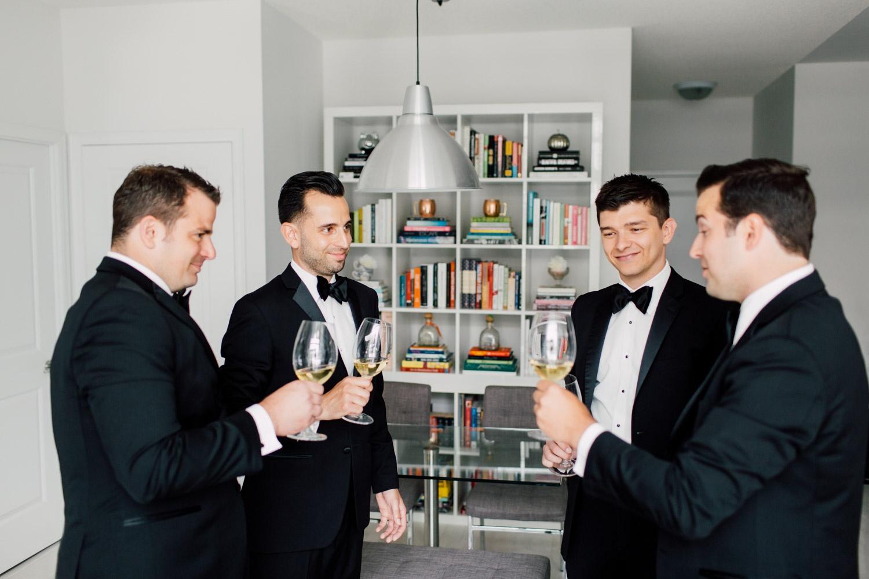 groomsmen having a drink