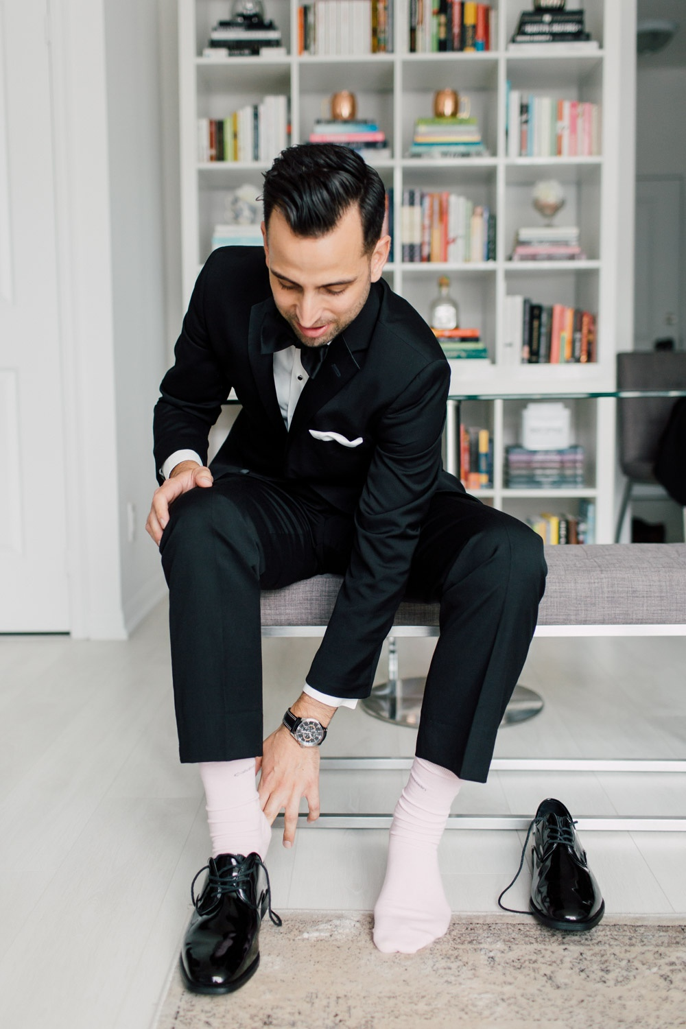 groom putting on the shoes
