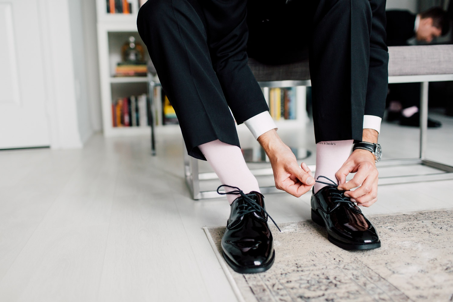 groom doing up his shoes
