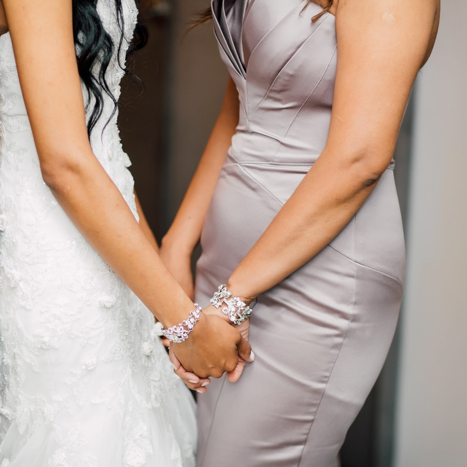 bride and maid of honer holding hands