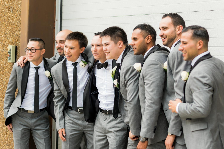 groomsmen posing for photos