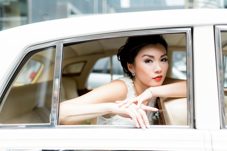 bride posing in a limo