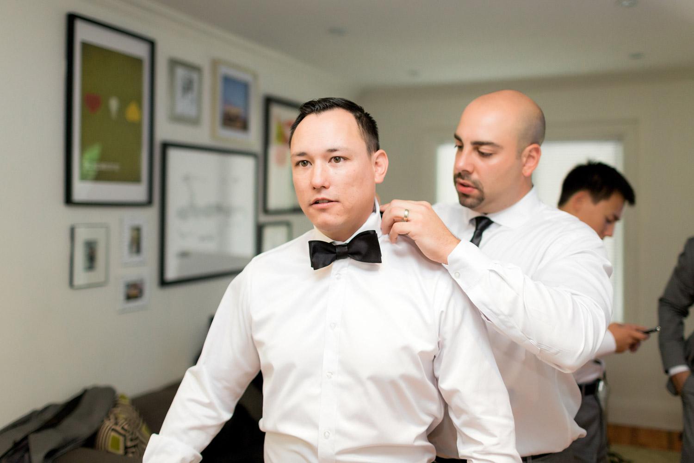 groom and black bowtie