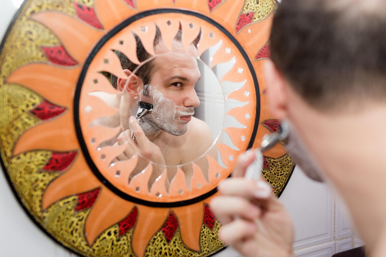 groom shaving for the wedding