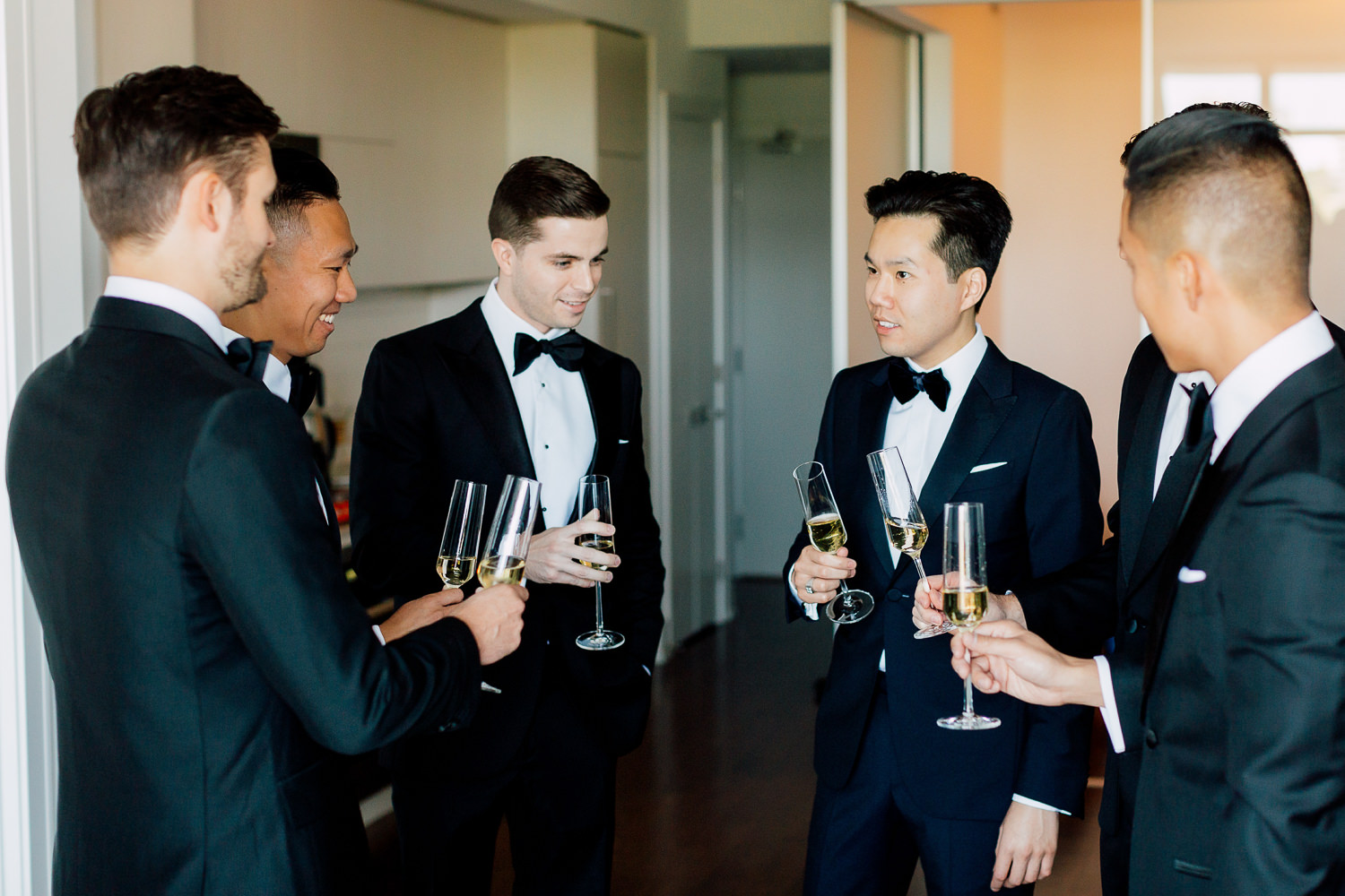 groom and groomsmen drinking