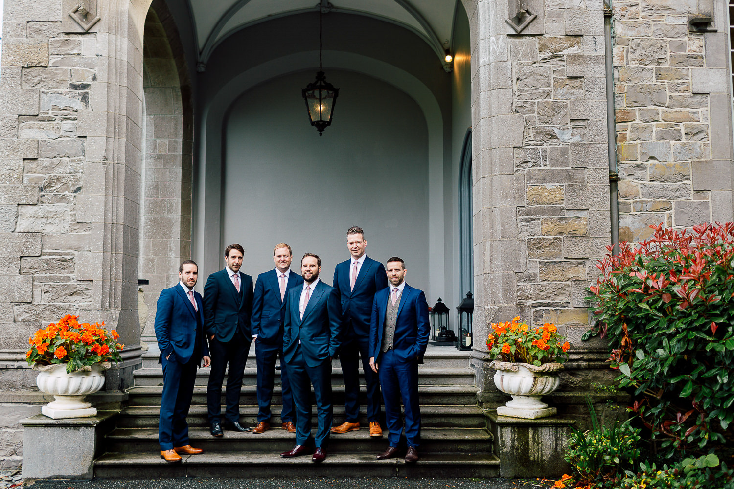 groomsmen castle portrait