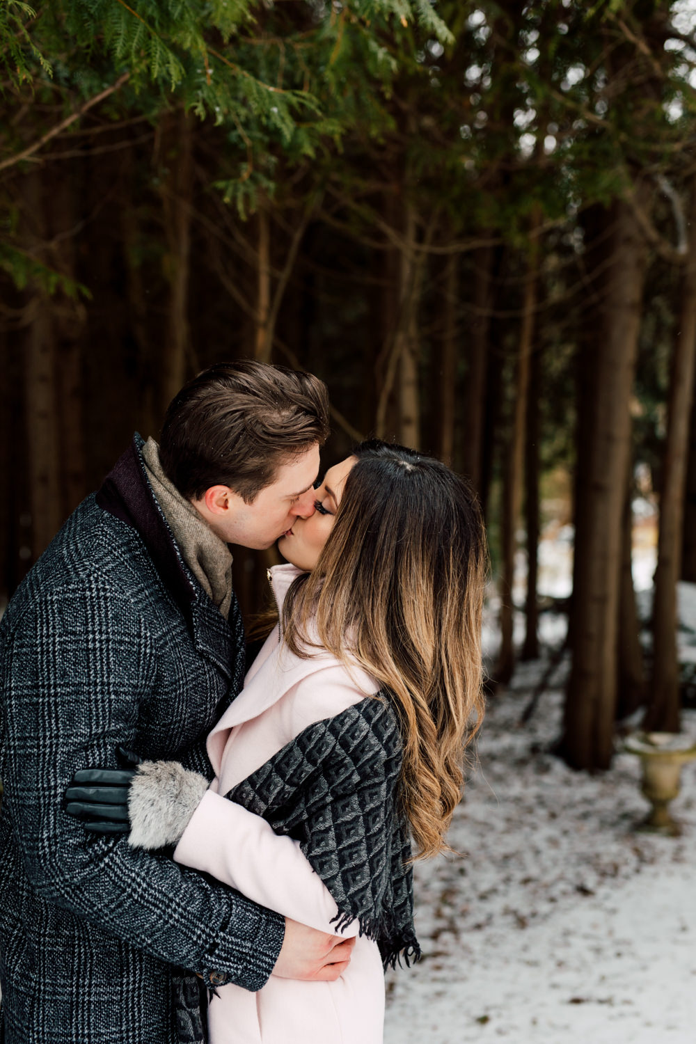 couples kissing in snow