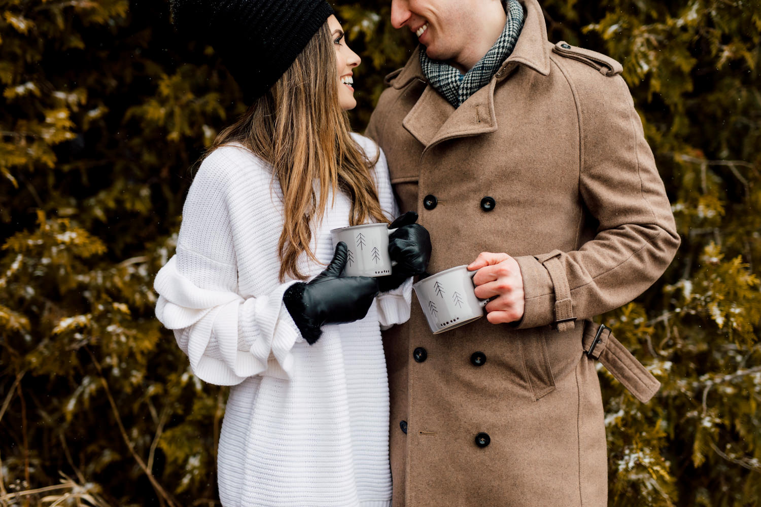 couple holding mugs