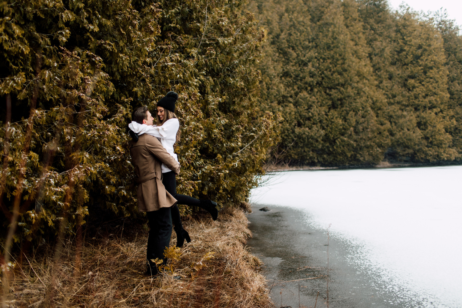 winter engagement by the lake