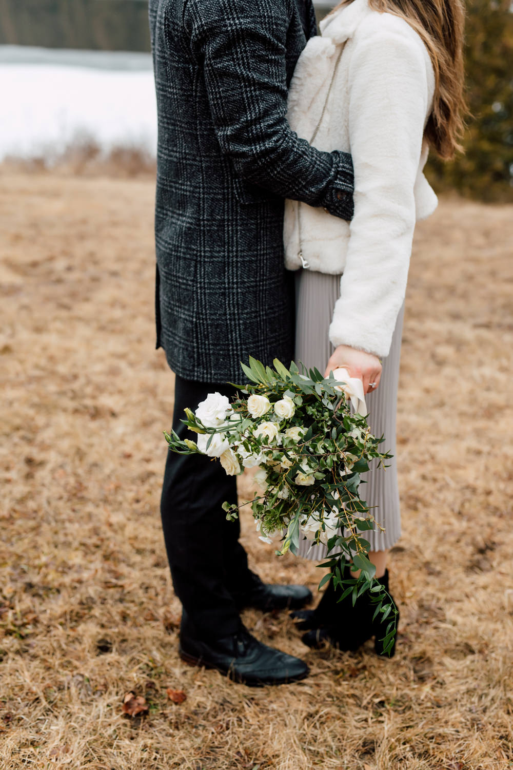 kissing with bouquet in hand