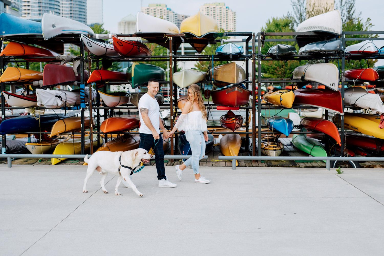 couple walking with dog