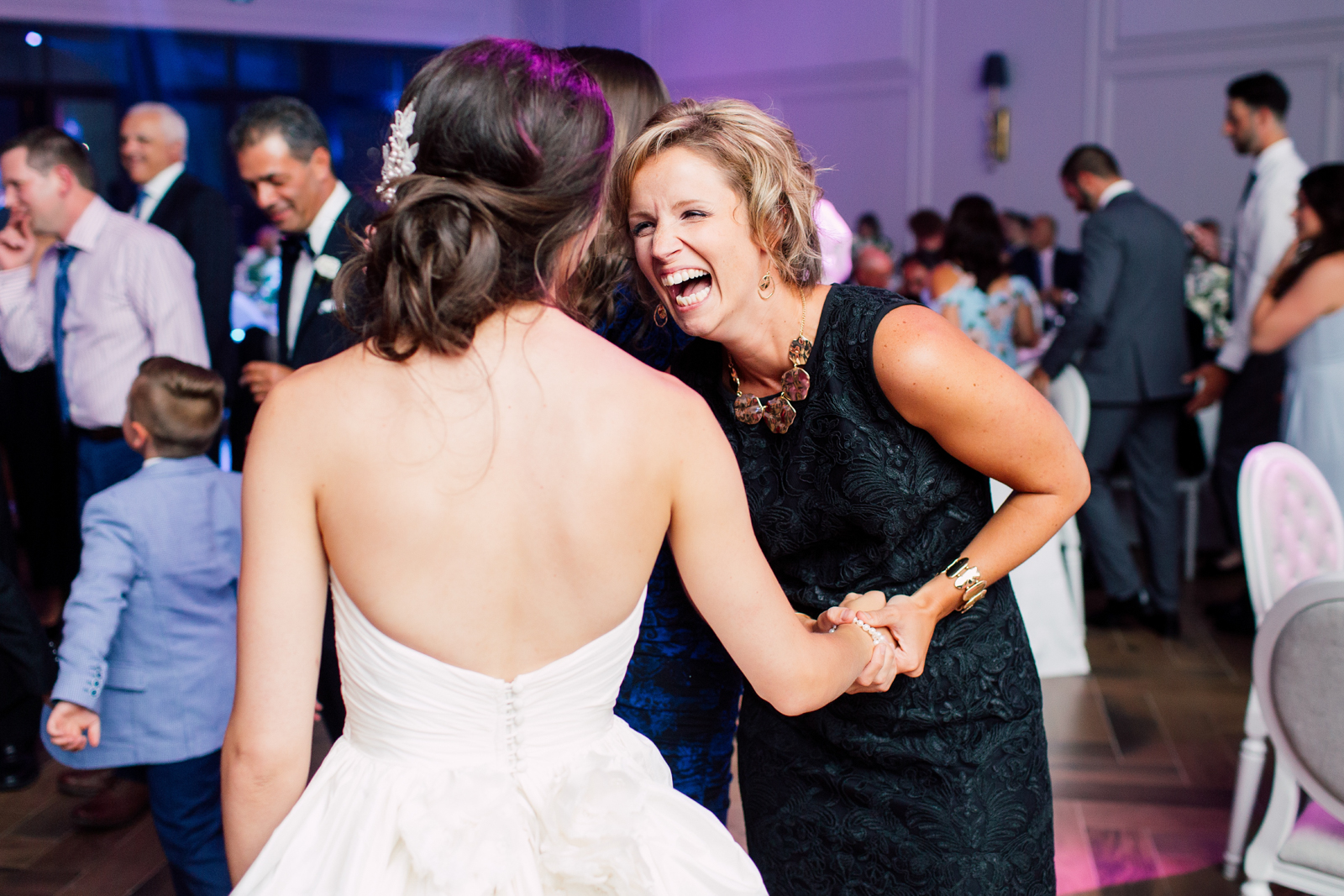 wedding guest laughs