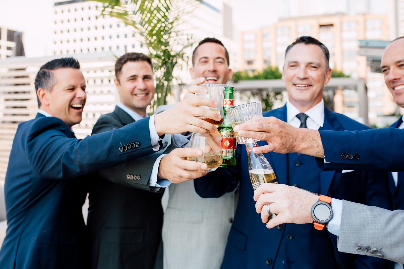 groomsmen toasting