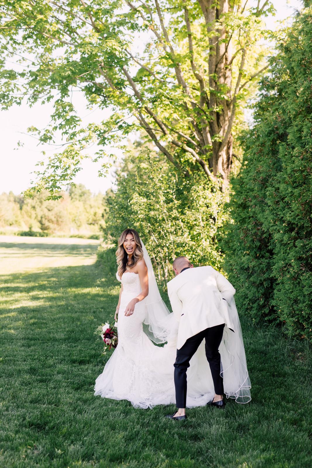Groom helping bride