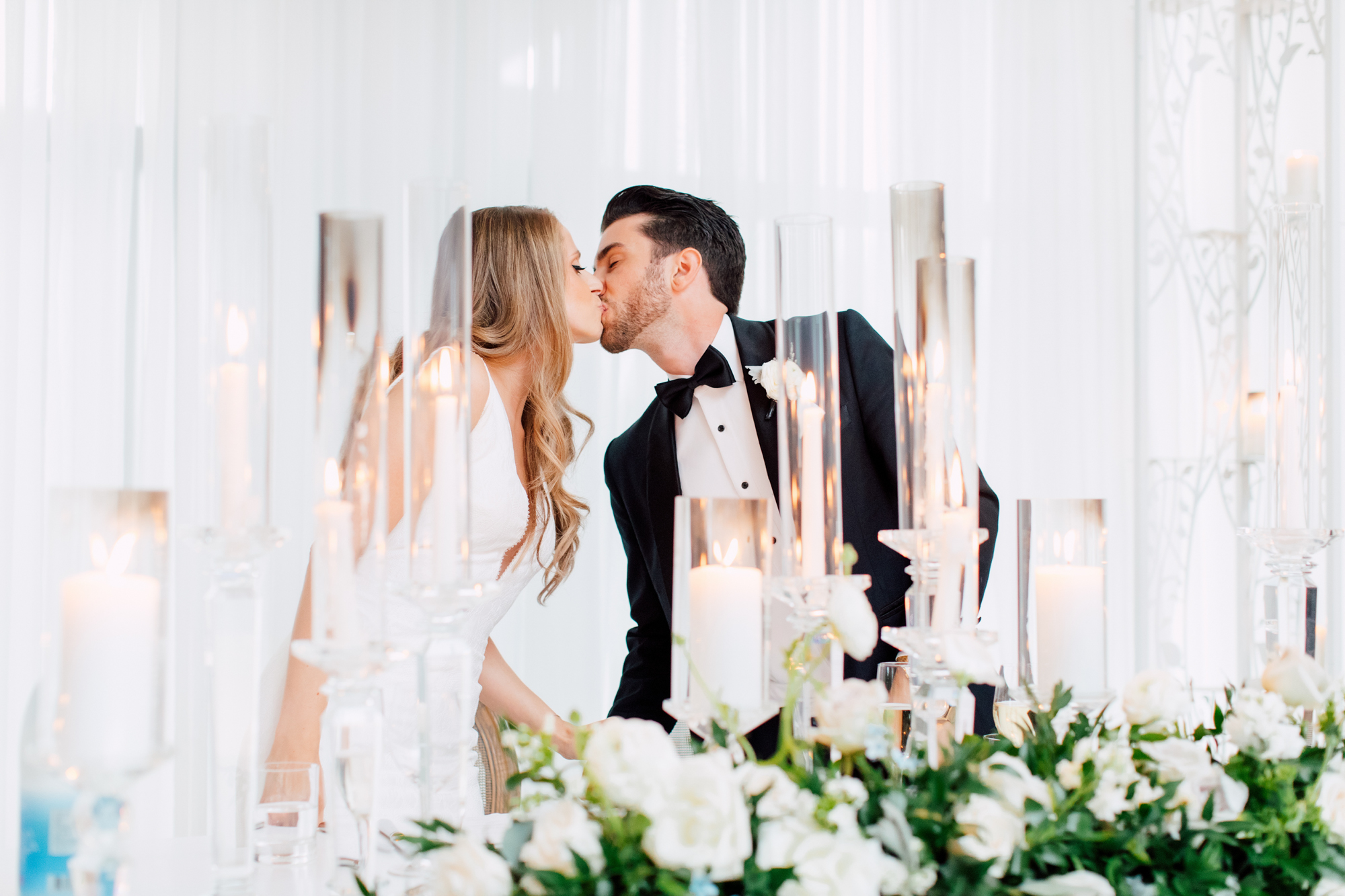 reception bride and groom kiss