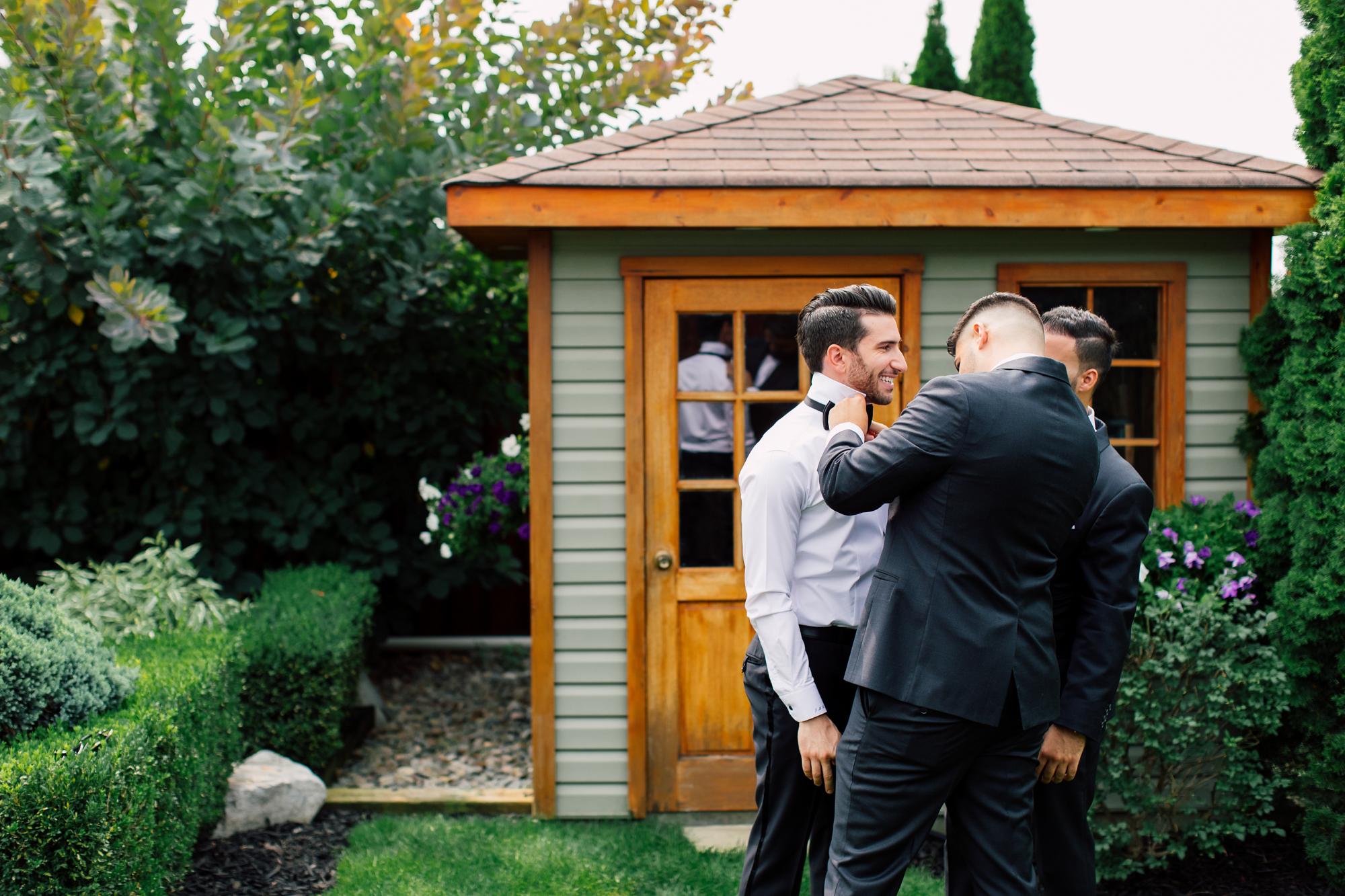 groomsmen dressing groom