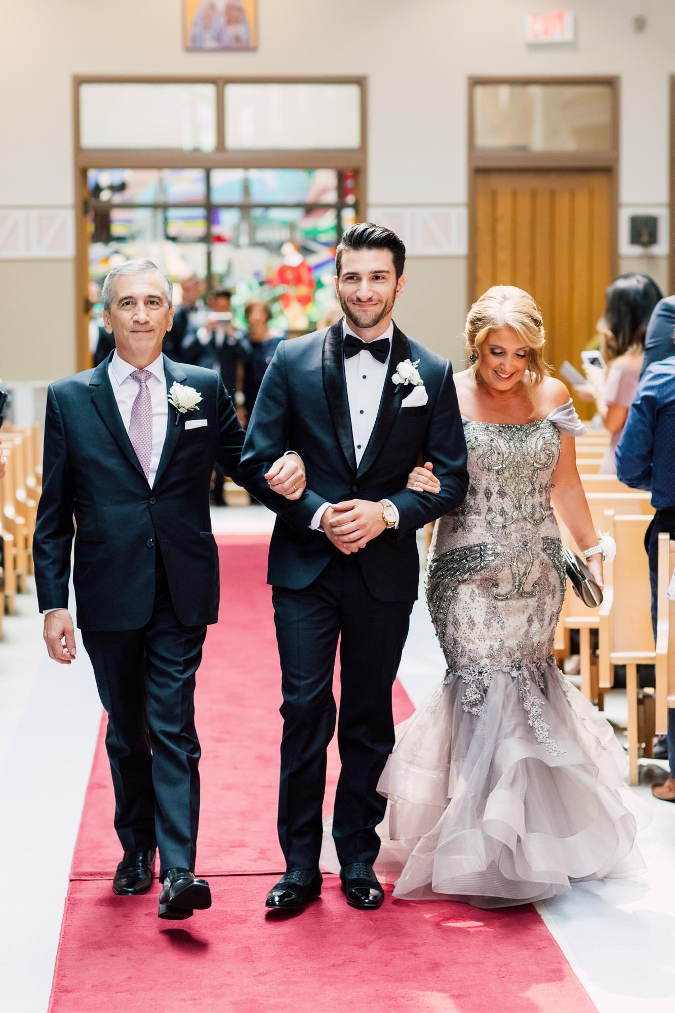 groom walking down aisle