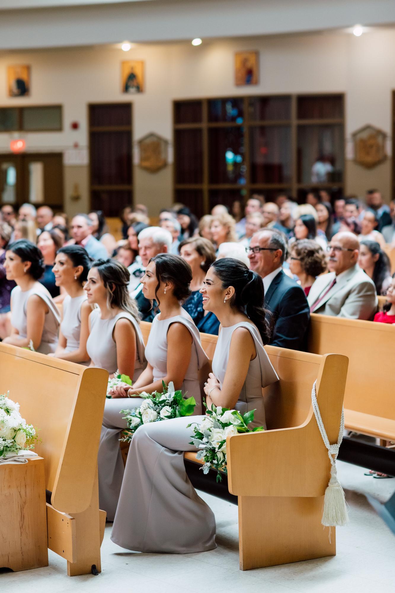 bridesmaids watching ceremony