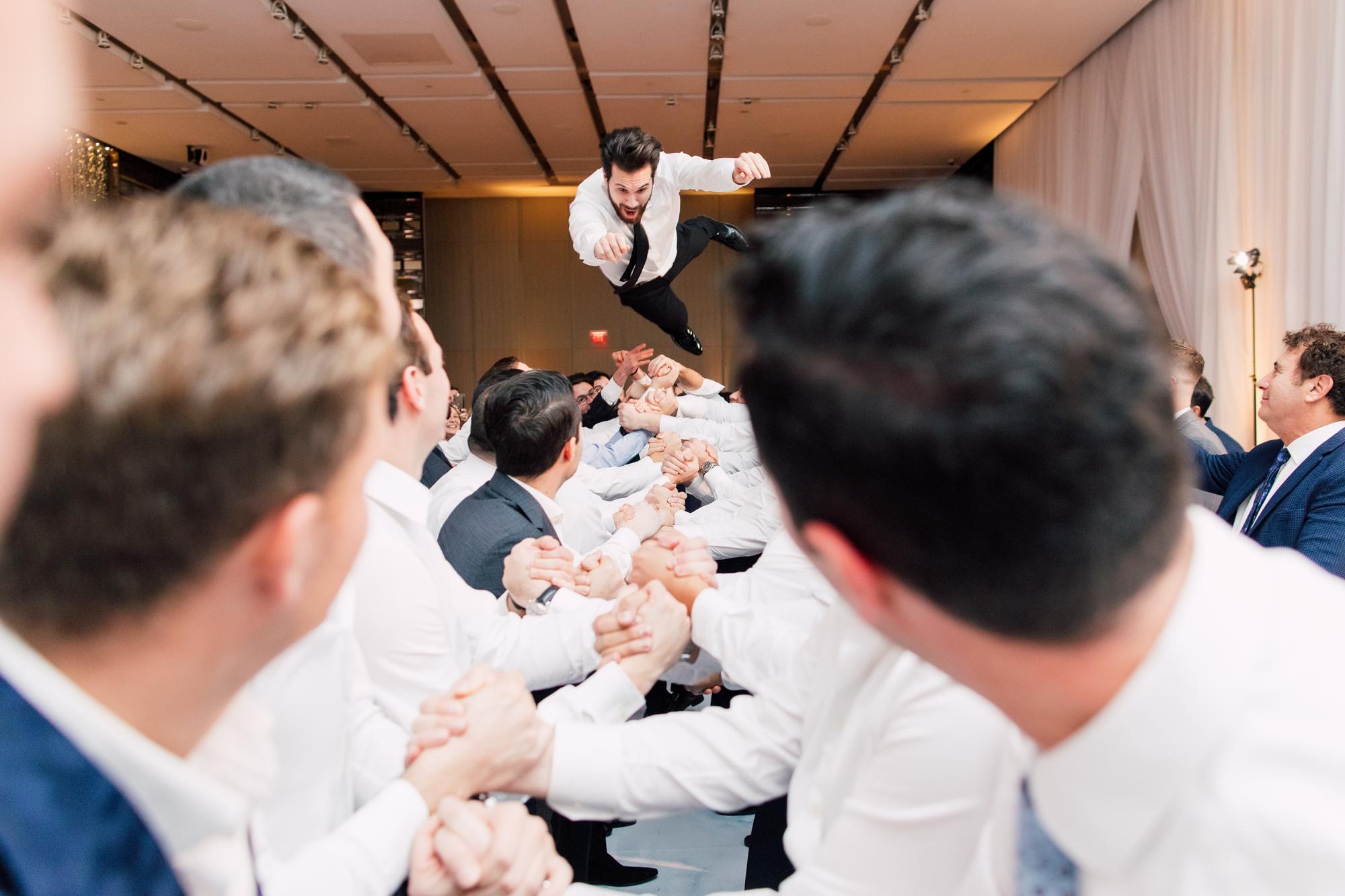 groom jumping wedding
