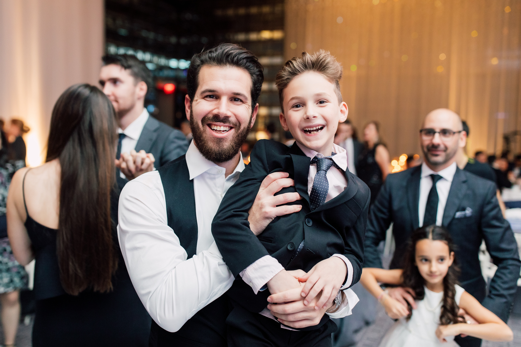 laughing groom and ring bearer