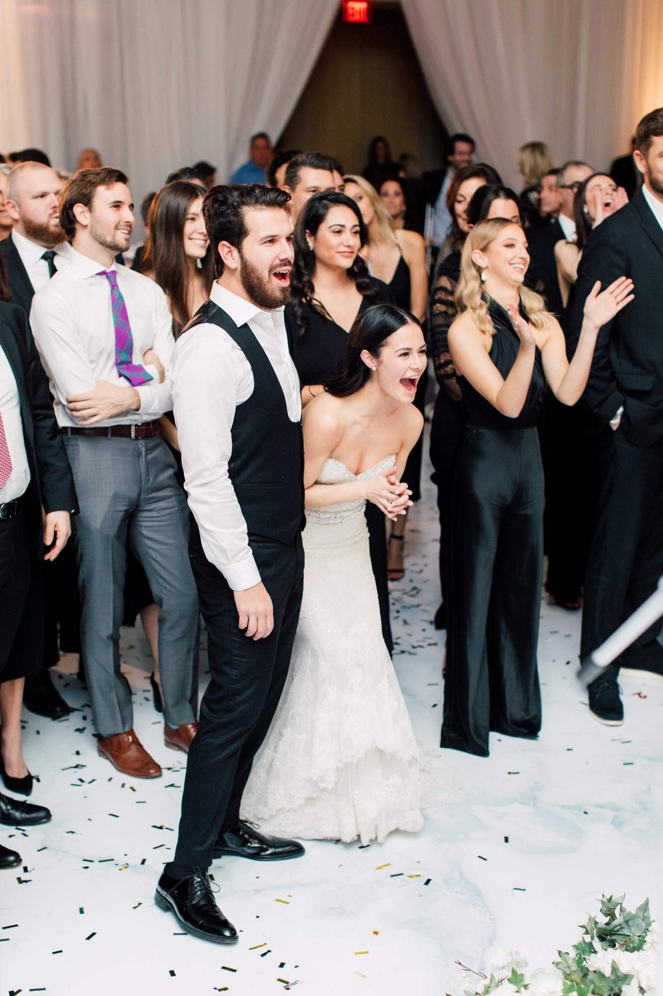 laughing wedding reception