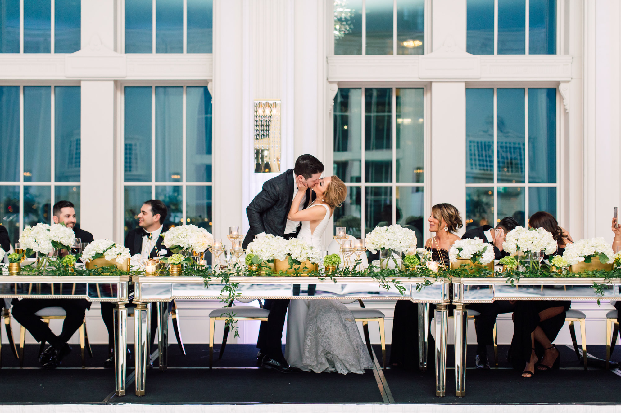 bride and groom kiss reception