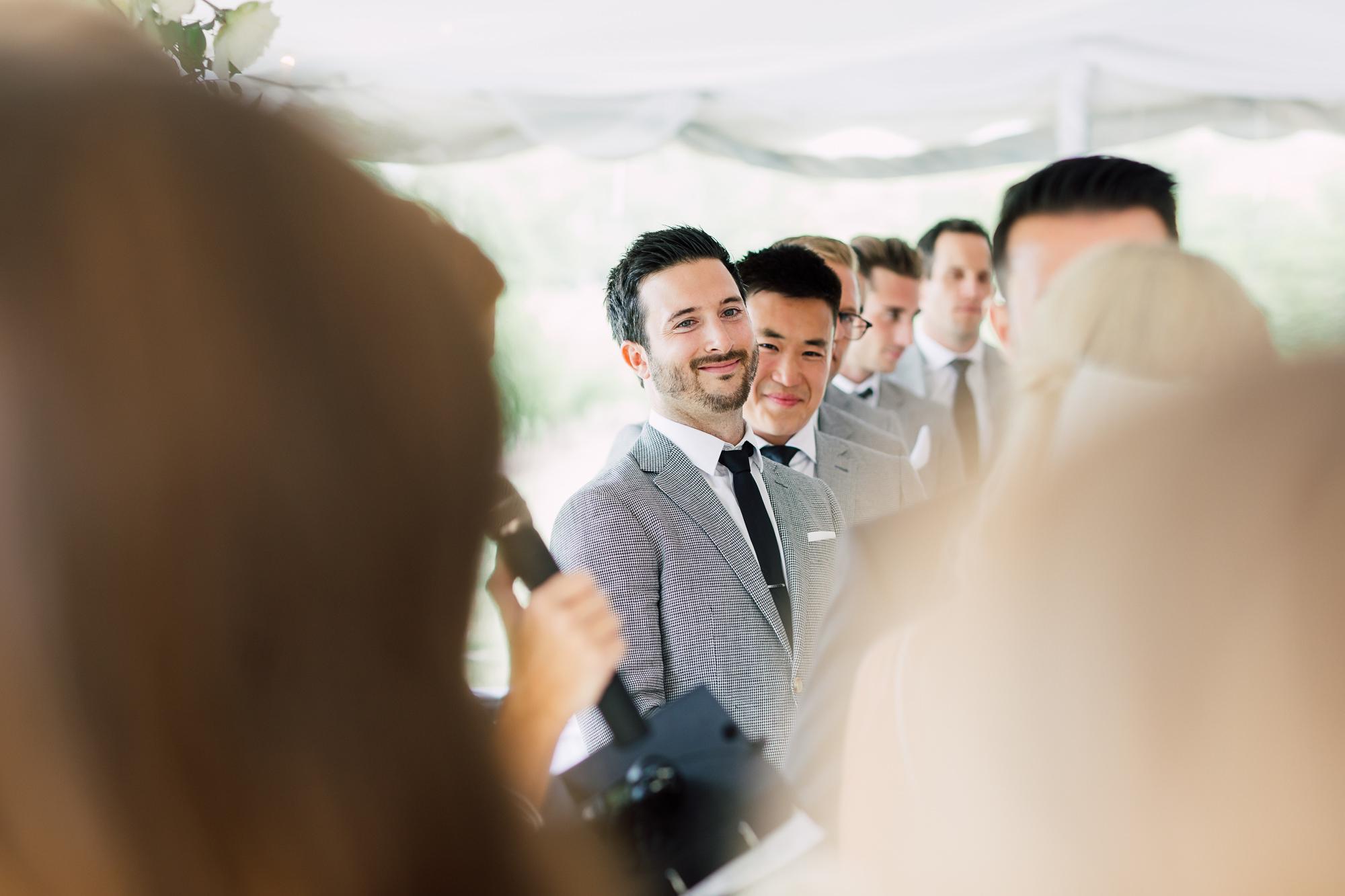 candid groomsmen ceremony